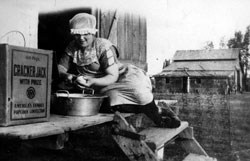 Signa Hermanson Larsen peeling potatoes for cooking, Burke County ND 1923