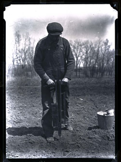 Man using corn drill 1925