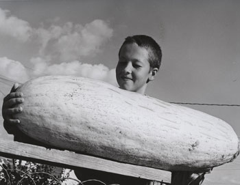 11 year old boy holding 47 pound banana squash