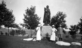 Two Women and One Man with Sakakawea Statue