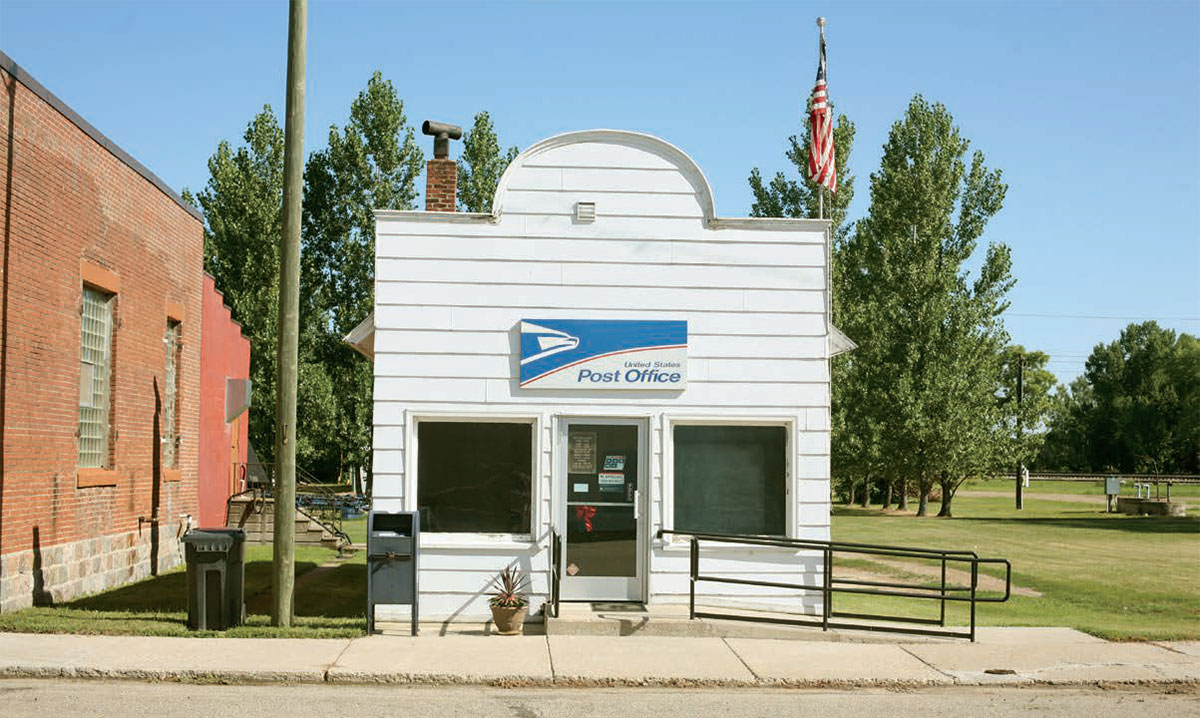 white building with a United States Post Office sign