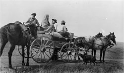 Crow's Heart, Mrs. Crow's Heart, Frances Densmore, and Charles Hall in a wagon