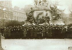 large group of Red Cross nurses, doctors, and support staff gathers for a portrait in Paris at the statue of Gambetta