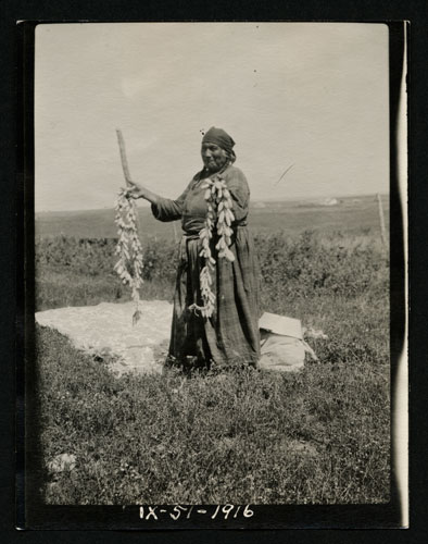 Woman with String of Prairie Turnips
